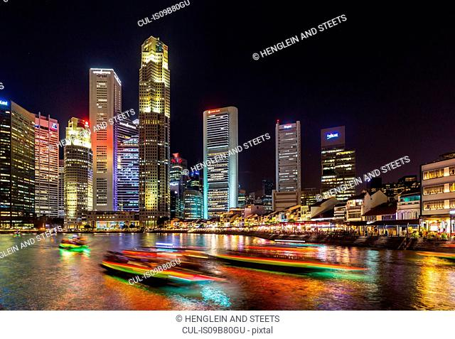 View of Singapore river and skyline at night, Singapore, South East Asia