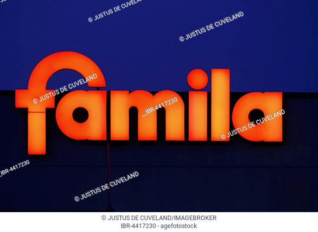 Illuminated company logo sign of supermarket and department store chain Famila, Germany