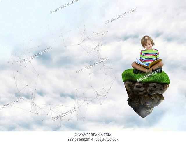 Young boy on floating rock platform in sky reading book