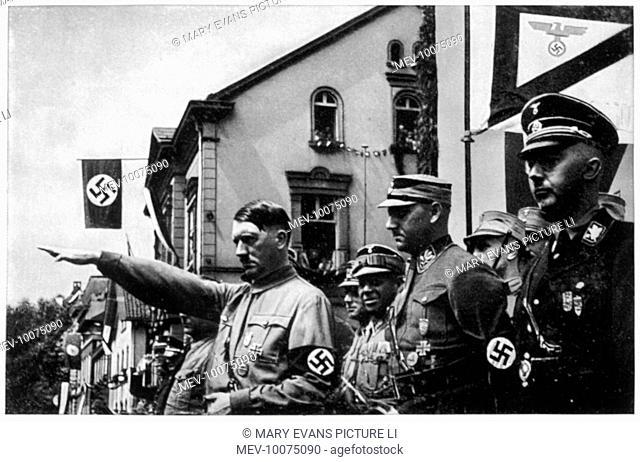 ADOLF HITLER Reviewing his supporters, circa 1933