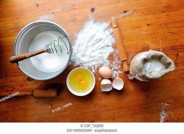 flour on wooden background