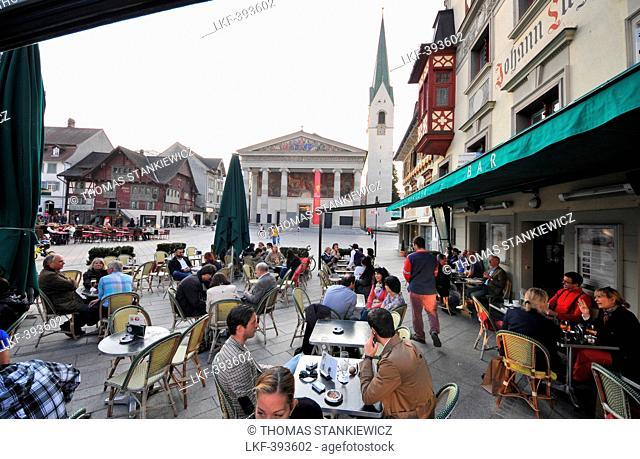 People in street cafes at the red house, Dornbirn, Vorarlberg, Austria, Europe