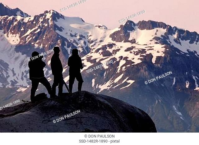 Hikers on a hilltop, Reid Glacier, Glacier Bay National Park, Alaska, USA