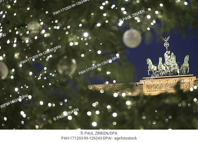 The Christmas tree shines bright in front of the Brandenburg Gate in Berlin, Germany, 03 December 2017. The lights were ignited during a small ceremony