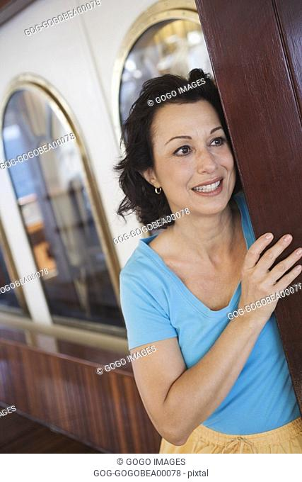 Woman clutching wooden panel