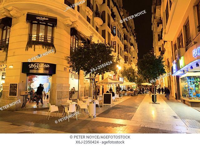 Carrer del Convent de Santa Clara pedestrian street with cafe tables at night