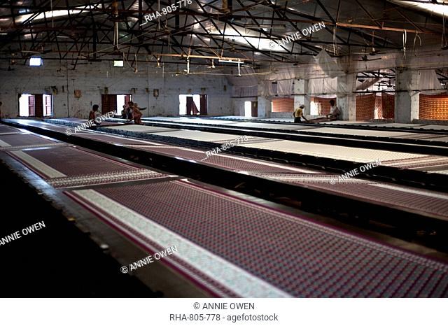 Screenprinting factory, men printing sari lengths of cotton by hand, Bhuj district, Gujarat, India, Asia