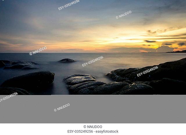 Long Exposure of Sunset at the sea,Larn hin khao , Rayong,Thailand , sunset at White rock beach , Rayong