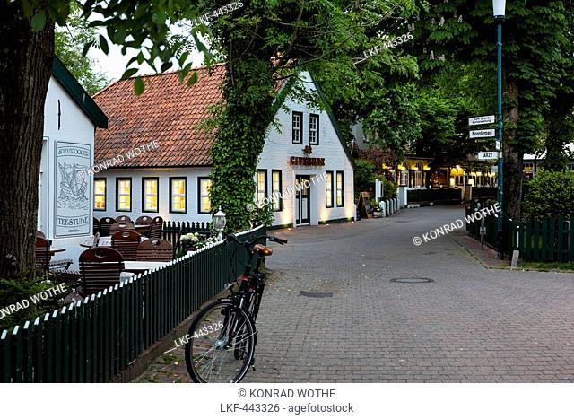 Street in Spiekeroog at dusk, Spiekeroog Island, Nationalpark, North Sea, East Frisian Islands, East Frisia, Lower Saxony, Germany, Europe