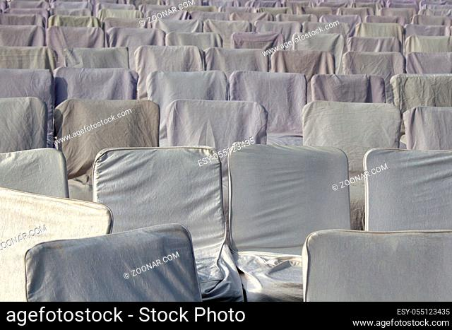 Sitting with white covers in the meeting room of the religious community, empty seats. India