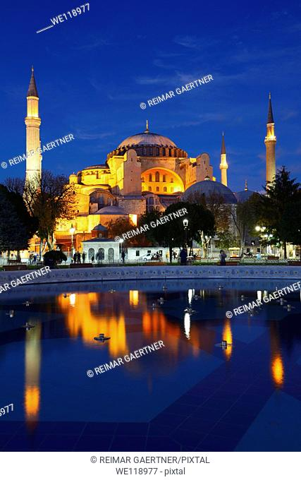 Lights on Hagia Sophia at dusk with reflections in fountain Istanbul Turkey