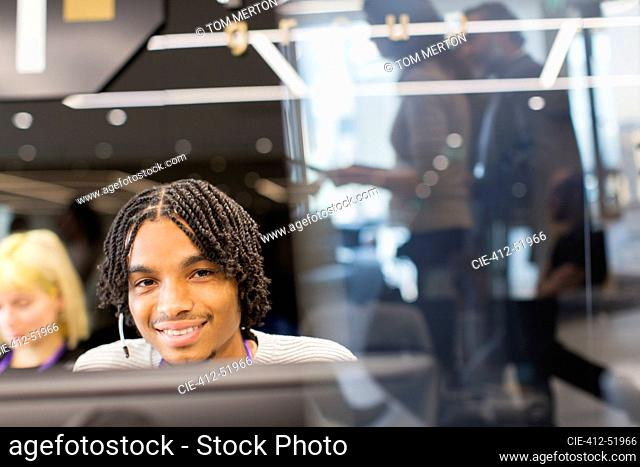 Portrait confident businessman with headset in office