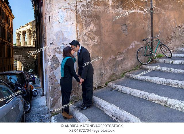 Couple kissing in the streets of Rome Italy