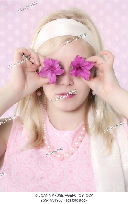a girl in 60s style with two purple flowers in front of her eyes