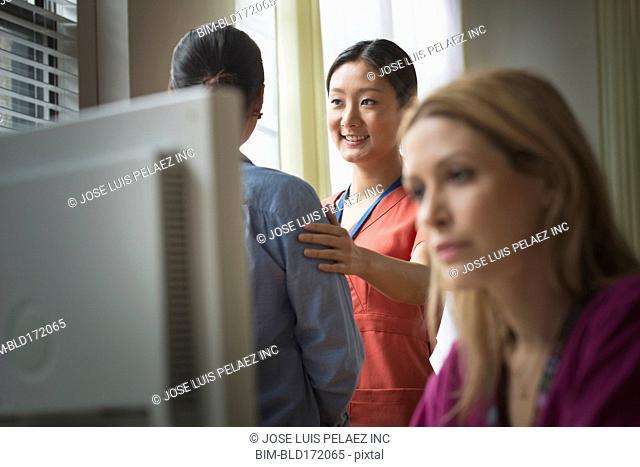 Nurses working in doctor's office