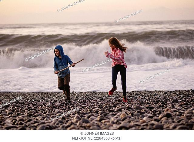 Two girls playing by sea