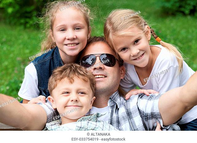 Father and children playing at the park at the day time