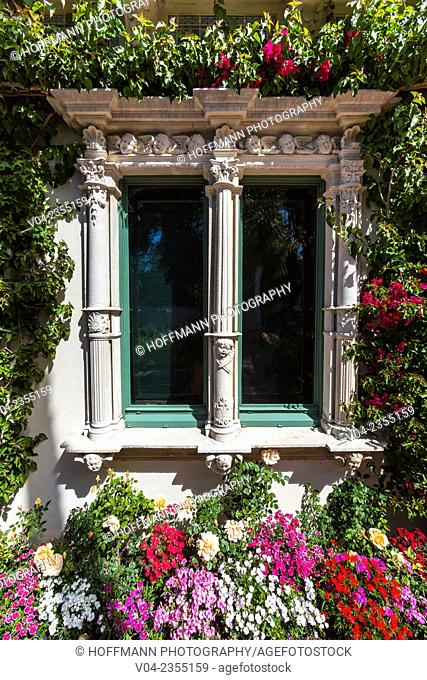 Close up of a window with lots of flowers at Hearst Castle, California, USA