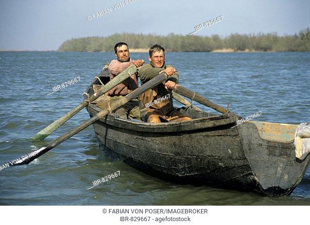 Fishermen on a Danube arm near Tulcea County, Danube Delta, Romania, Europe