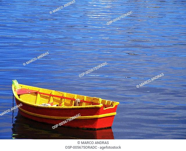 an empty lonely boat at rio de janeiro sea water