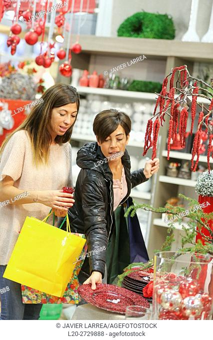 Women buying Christmas ornaments in garden center