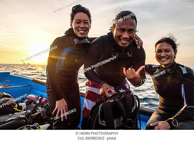 Divemaster and tourists on dive boat, Tubbataha Reefs Natural Park, Sulu Sea, Philippines