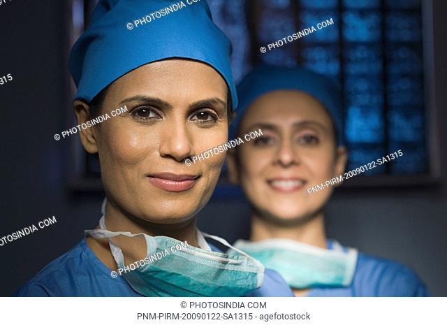 Portrait of two female surgeons smiling, Gurgaon, Haryana, India