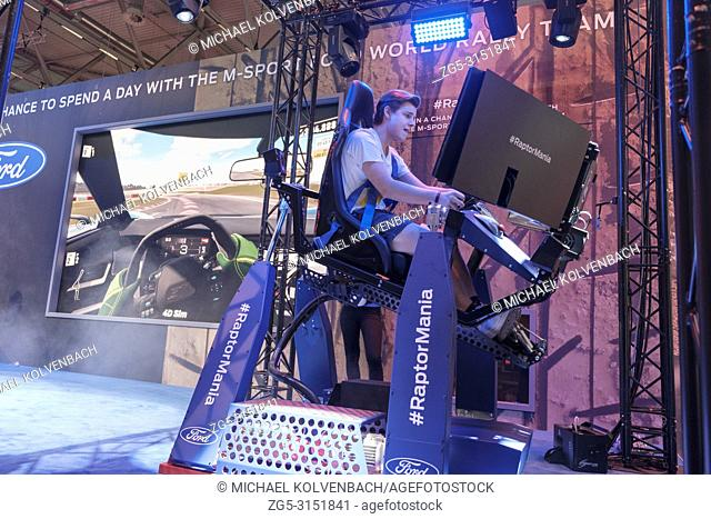 ae077a1a5975 Visitor in the 4D driving simulator of Ford RaptorMania at the world s  largest fair for computer