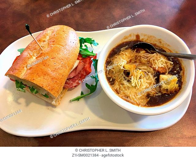 Bistro French Onion soup and a Hogagie roll sandwich of smoked lean ham, Salami and provolone cheese