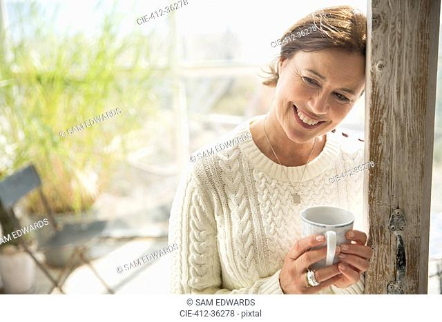Portrait smiling mature woman drinking coffee
