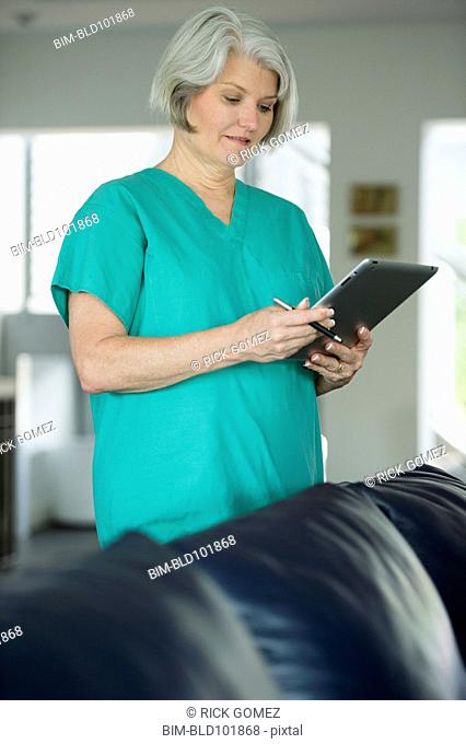 Caucasian surgeon using digital tablet