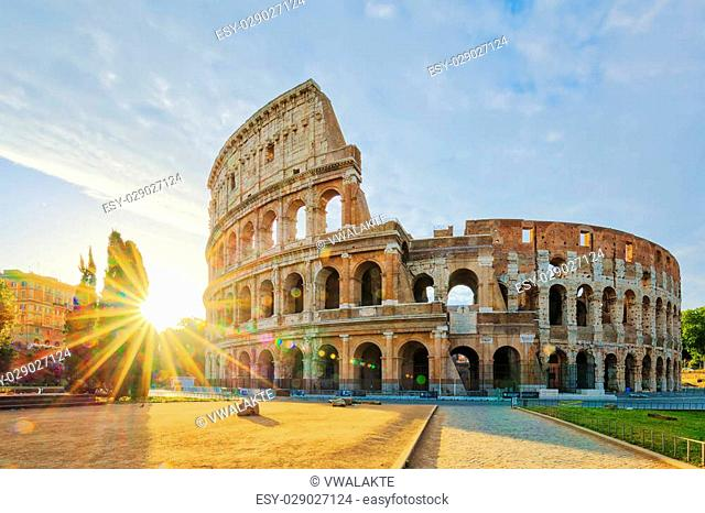 Colosseum in Rome and morning sun, Italy, Europe