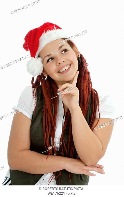 Young modern girl wearing Santa Claus hat isolated on white background