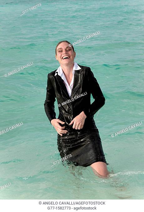 Maldives Islands Ari Atoll Business woman in sea