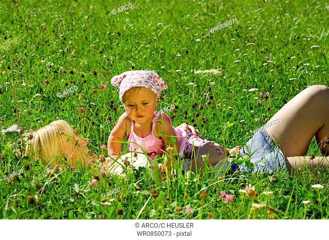 Mother and daughter in meadow