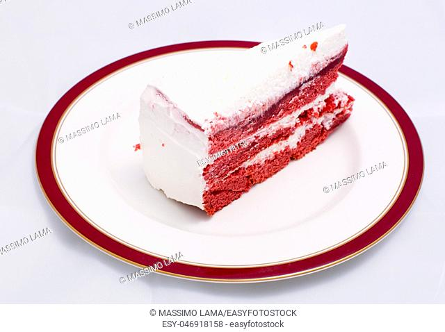 Red velvet cake is very dramatic looking with its bright red color sharply contrasted by a white cream