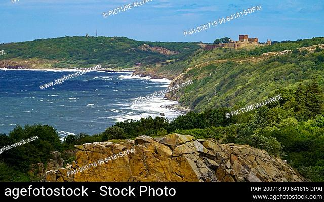 06 July 2020, Denmark, Allinge: View of the castle ruins of the medieval fortress Hammershus at the northwest tip of the Danish Baltic Sea island