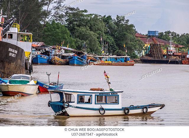 Small fishing boats at berthed along the river bank of Mukah, Sarawak, Malaysia