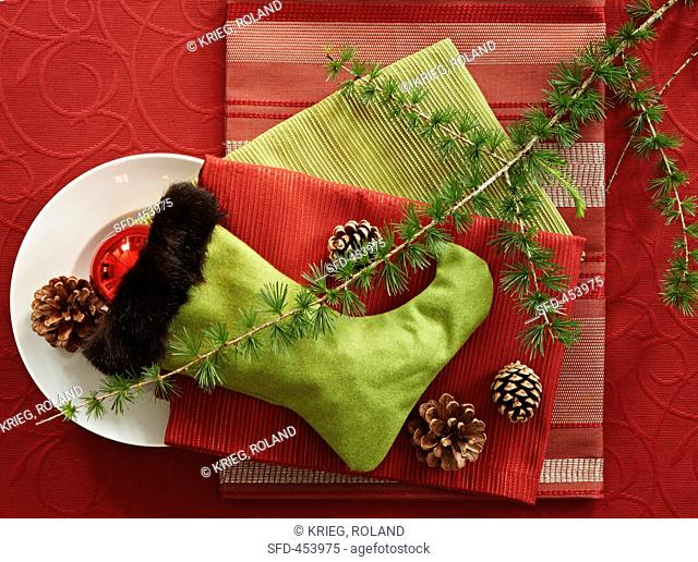 A Christmas stocking with decoration and table linen