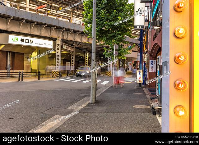 Underpass with metal pillar and neon signs at the west entrance of Kanda Station on the Yamanote Line. The street extends over 300 meters and has no less than...