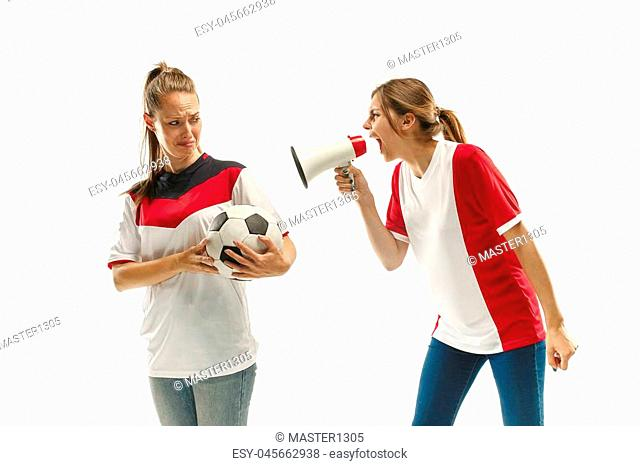 The unhappy and sad fans on white background. The young women in soccer football uniform at white studio. Fan, support concept. Human emotions concept