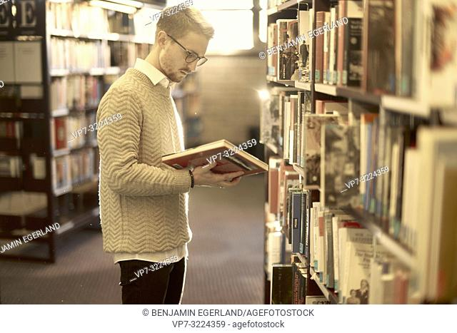 man holding book, library, glasses, student, university