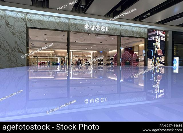 Gucci Boutique, luxury brand, luxury brand at London Airport, shop, store. - London/