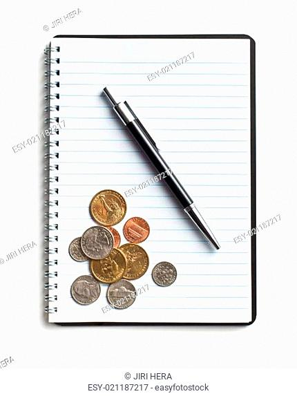 american coins and pen