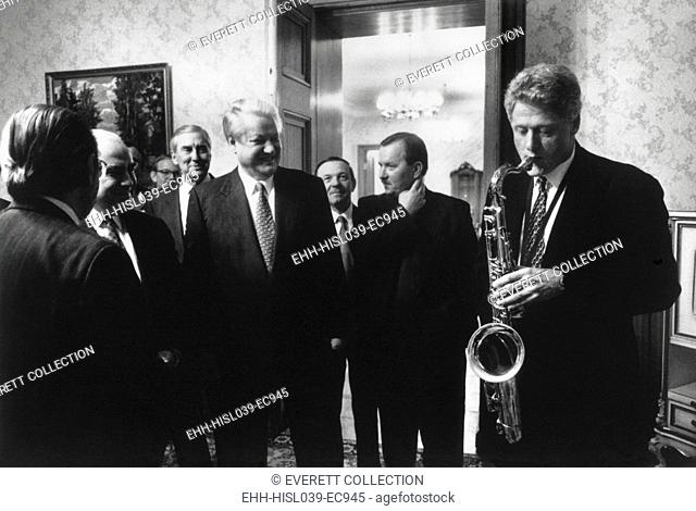 President Bill Clinton plays the saxophone presented to him by Russian President Boris Yeltsin. Yeltsin hosted a private dinner at Novoya Ogarova Dacha, Russia