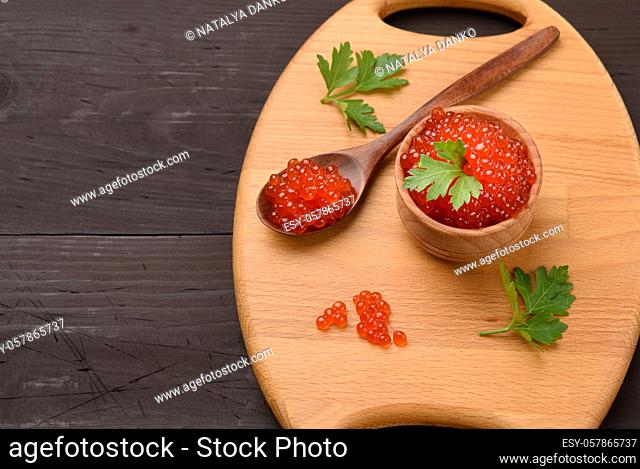 red chum salmon caviar in a wooden bowl, delicious and healthy food, top view