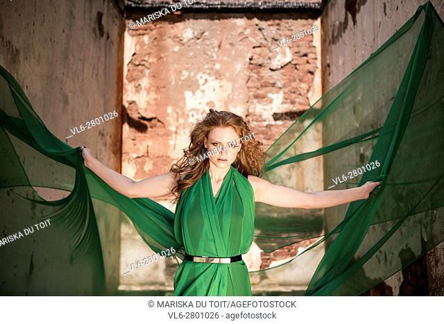 Woman in green chiffon dress