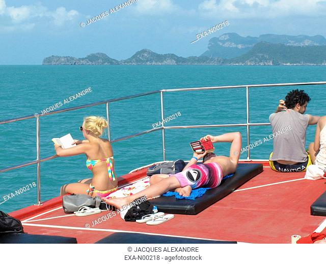 Tired Asian tourist on boat, Koh-Samui, Thailand, Asia
