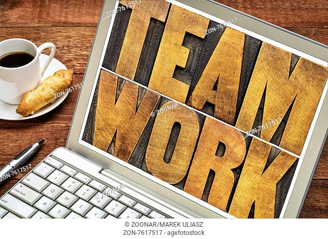 teamwork word typography - letterpress wood type printing blocks on a laptop screen with a cup of coffee