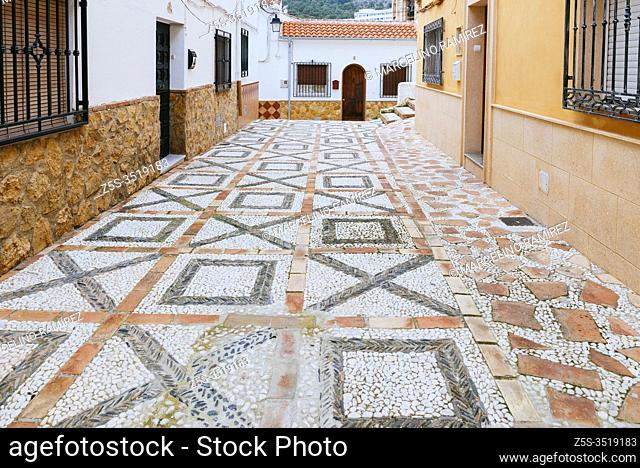 Paved street with Empedrado Granadino. This paving with pebbles was used by the Muslims of Granada and is known as Empedrado Granadino
